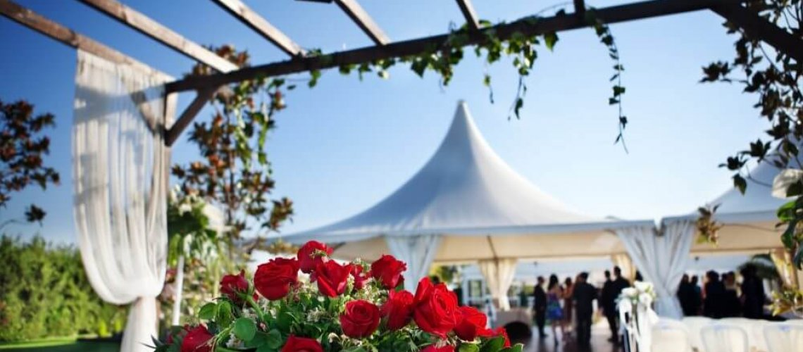 beautiful ceremony venue with flowers and blue sky